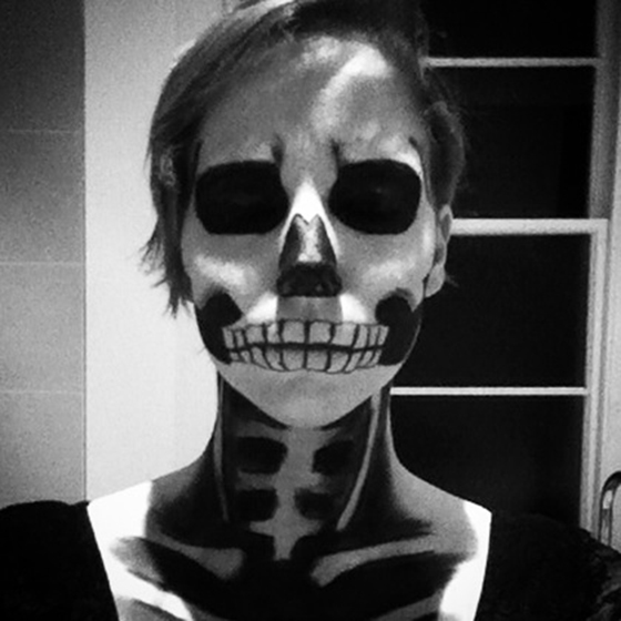 Black and white photo of halloween skeleton makeup yellow feather blog