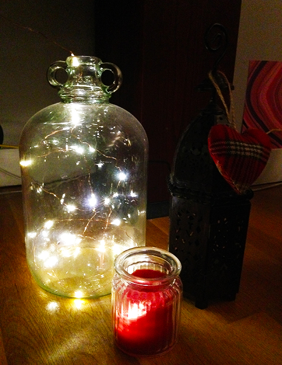 Fairy lights inside a demijohn, candle and lantern with tartan hart autumnal house tour yellow feather blog