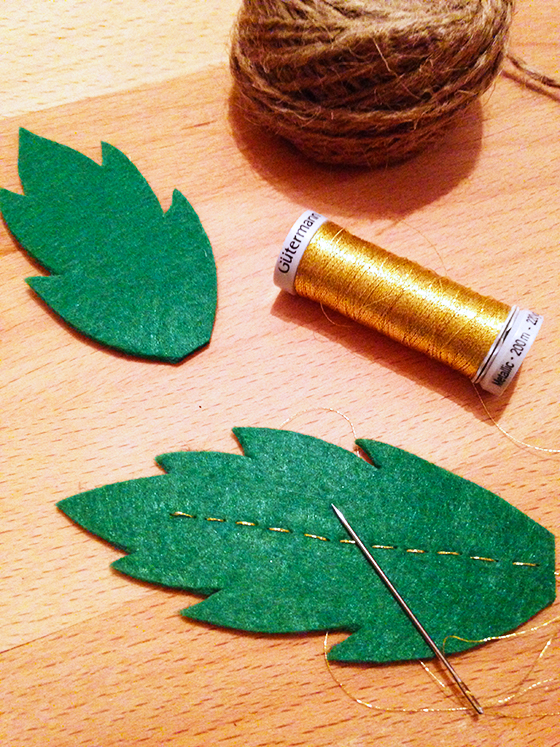 DIY Autumn wreath: felt leaf being embroidered with gold thread - yellow feather blog