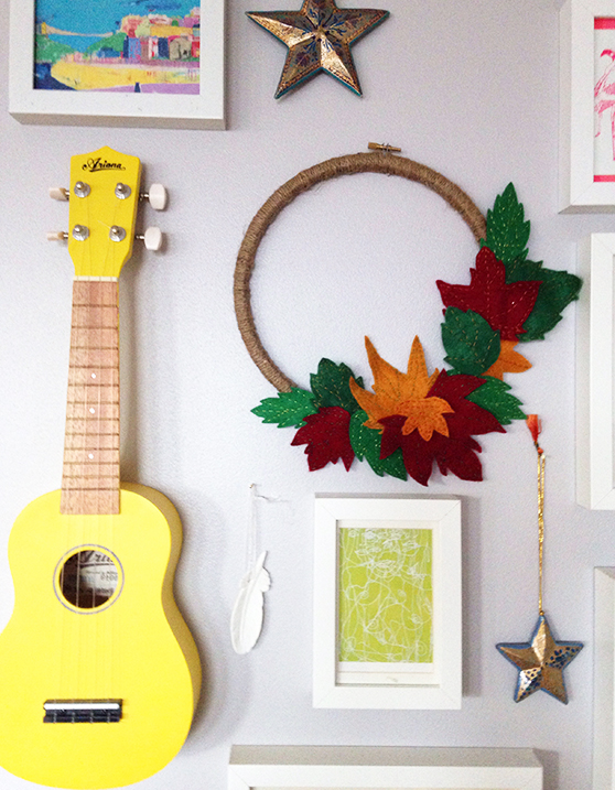 DIY wreath: the finished wreath in place on the gallery wall - yellow feather blog