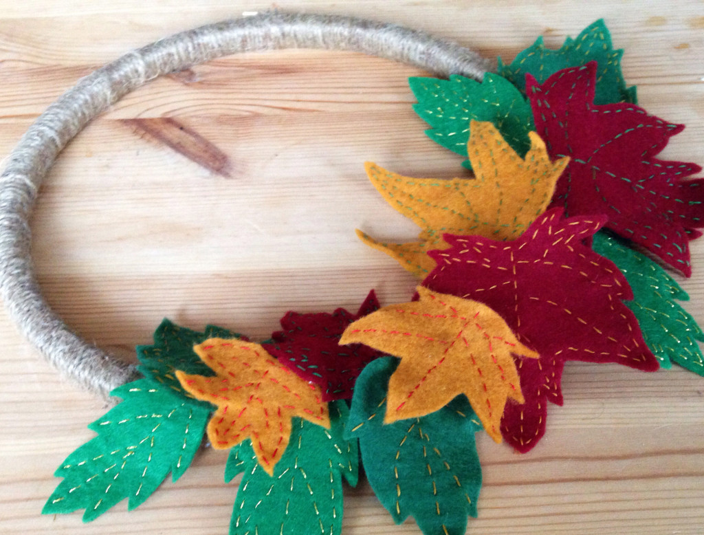 DIY Autumn wreath tutorial: close up of felt leaves on the complete wreath - yellow feather blog