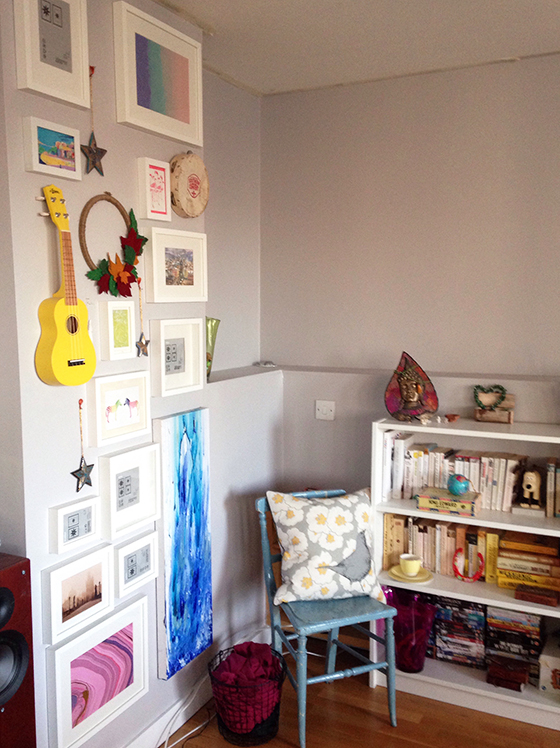 My favourite corner of the living room - the colourful gallery wall, vintage blue chair and colour-coordinated bookcase - Yellow Feather Blog living room tour