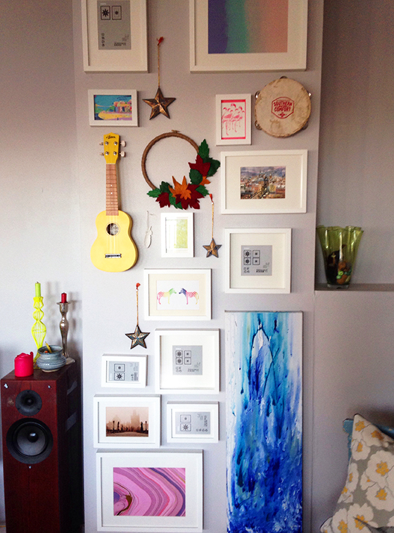 My colourful gallery wall - half finished. Complete with autumn wreath, yellow ukulele and tambourine - Yellow Feather Blog living room tour