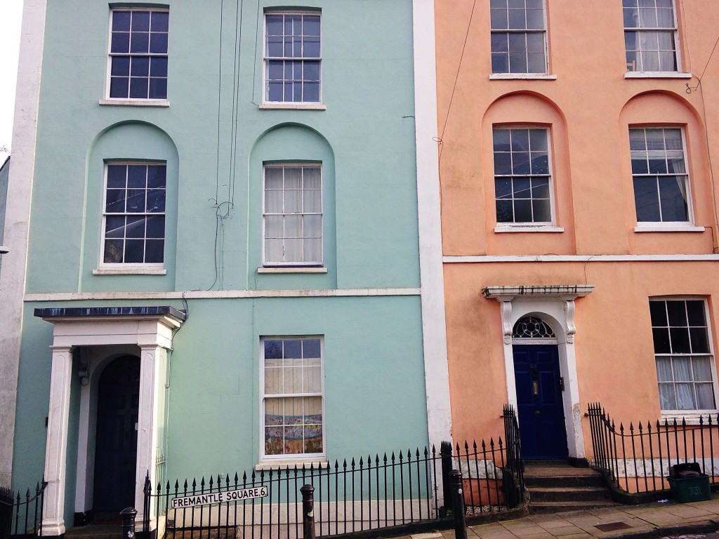 Coral and mint green painted houses in Kingsdown Bristol