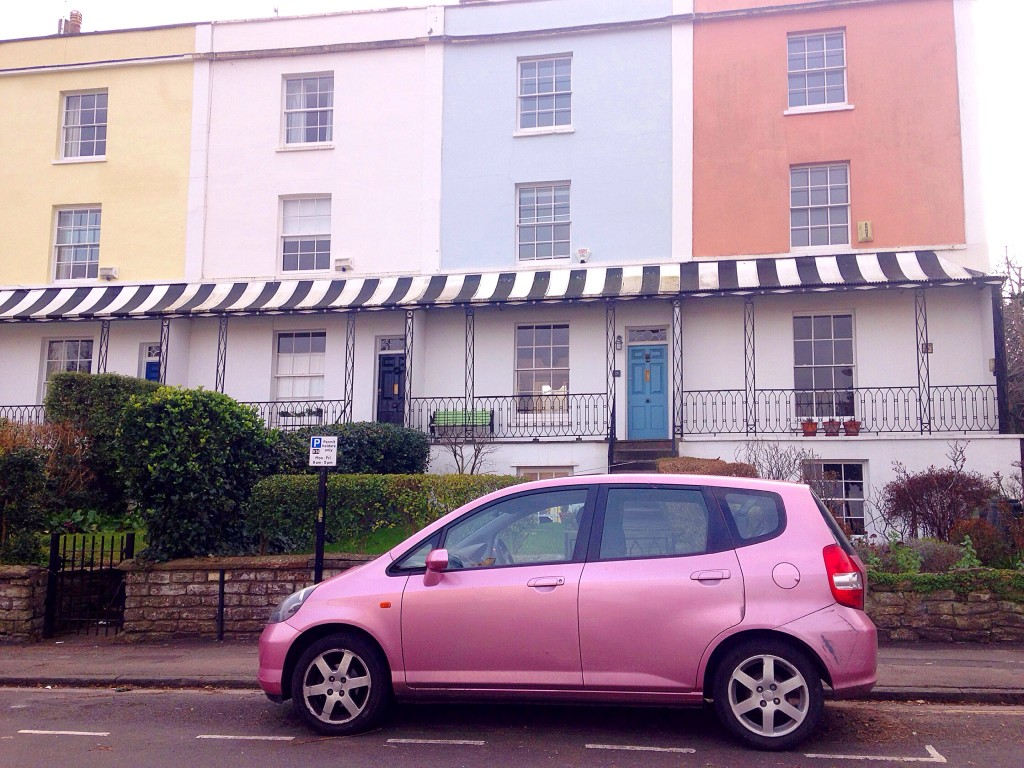 Pastel painted houses with a pink car Kingsdown Bristol