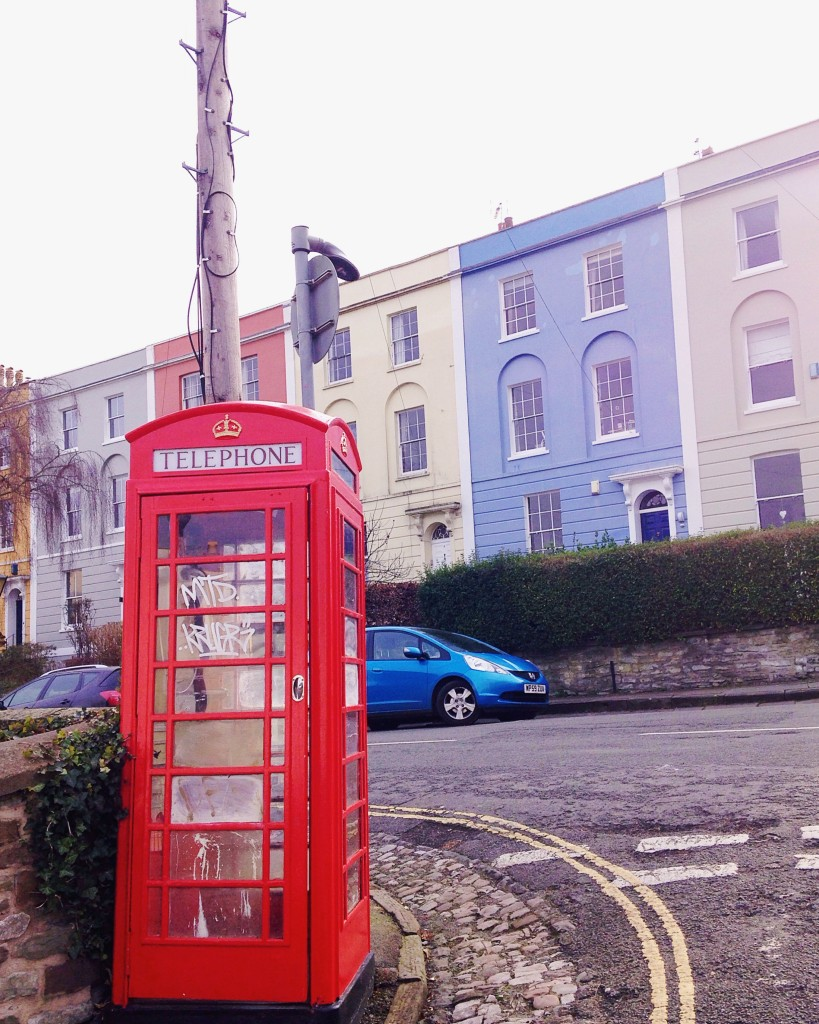Red telephone box in front of colourful houses in Kingsdown Bristol