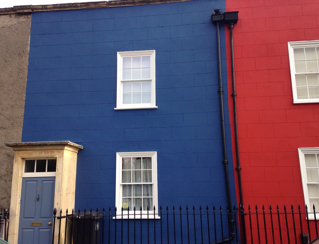 Royal blue and red painted houses in Kingsdown Bristol