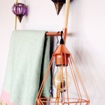 Decorative copper and wood ladder with copper wire hanging lamp
