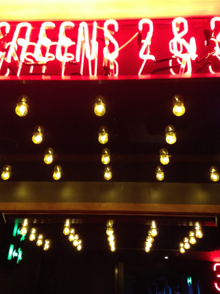 Close up of neon sign and lightbulb ceiling Everyman Cinema Bristol