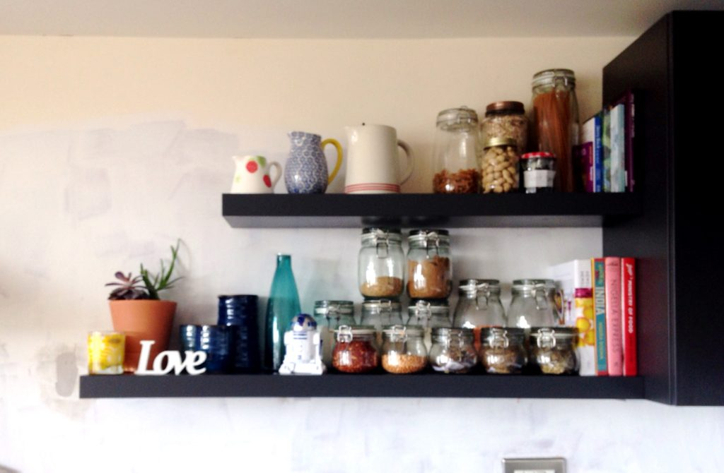 Dark grey floating shelves with kilner jar storage for dried goods