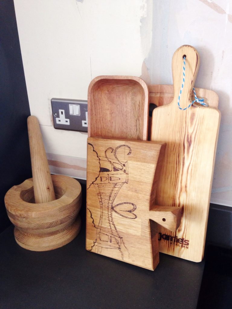 Rustic wooden pestle and mortar and chopping boards