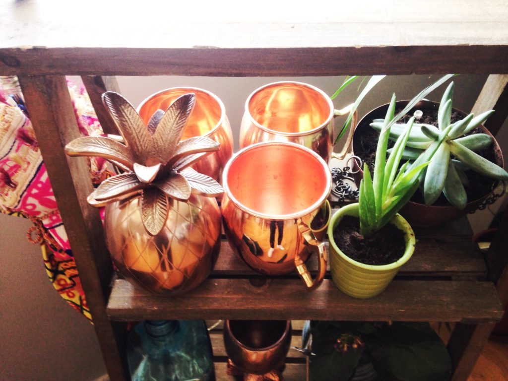 Use a plant stand to hold barware as well