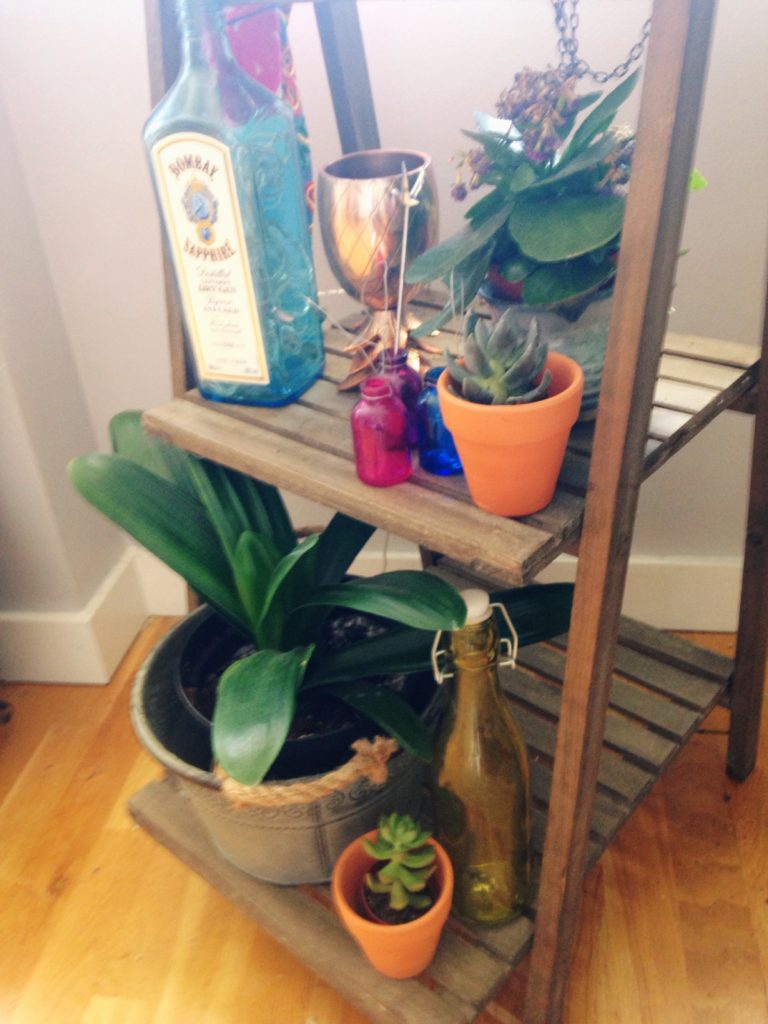 Yellow Feather blog using a plant holder to store barware