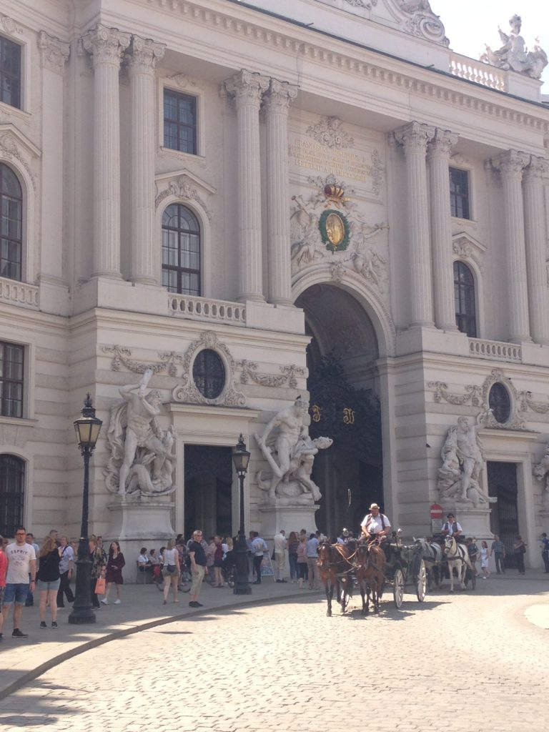 Horses and carriages outside Vienna Palace complex