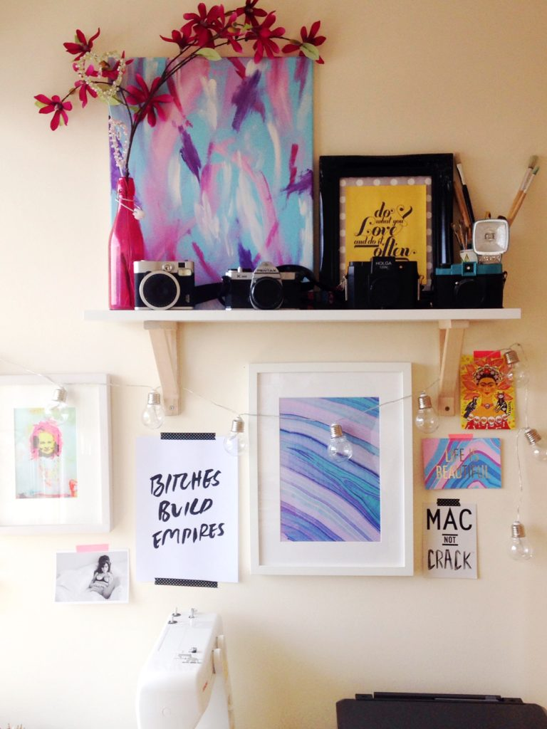 Gallery wall complete with local art, marble print and inspirational phrase