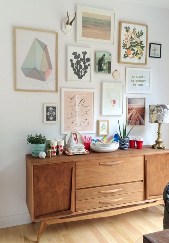 Example of gallery wall with mix of sizes and styles of artwork - How to add art to your home