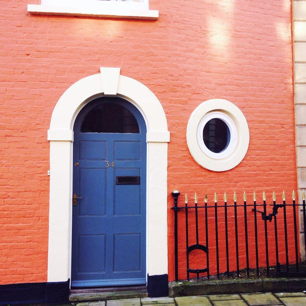 blue-door-on-orange-wall-bristol-doors-brunswick-square-st-pauls