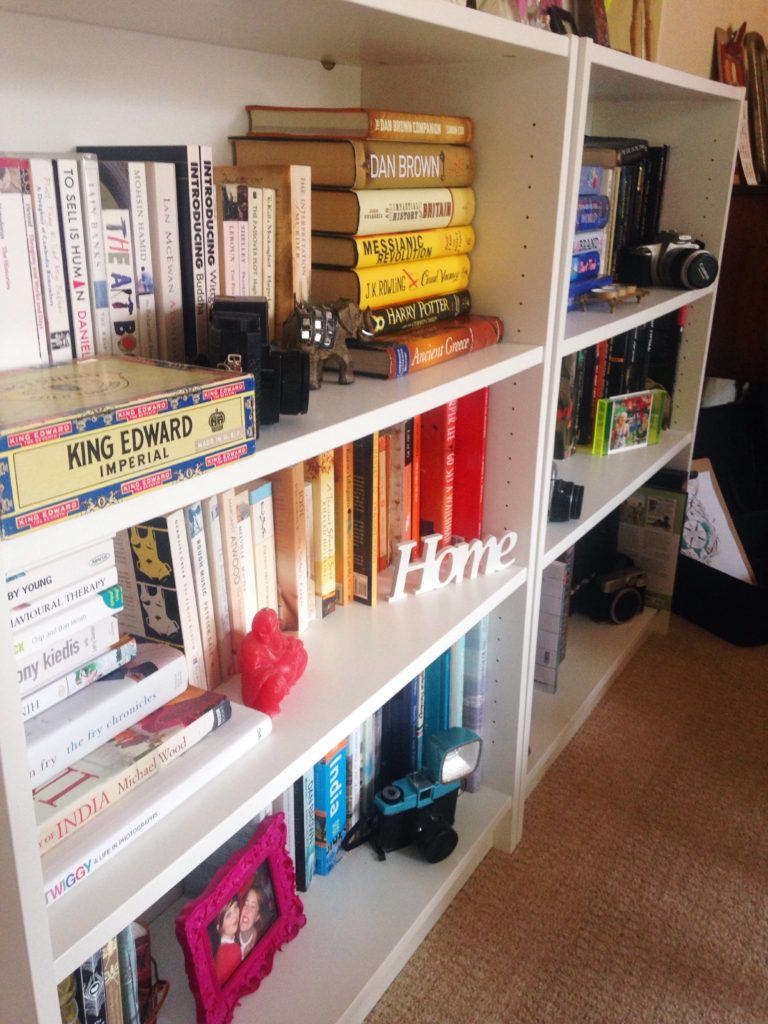 close-up-of-colourful-organised-books-yellow-feather-blog-living-room-tour