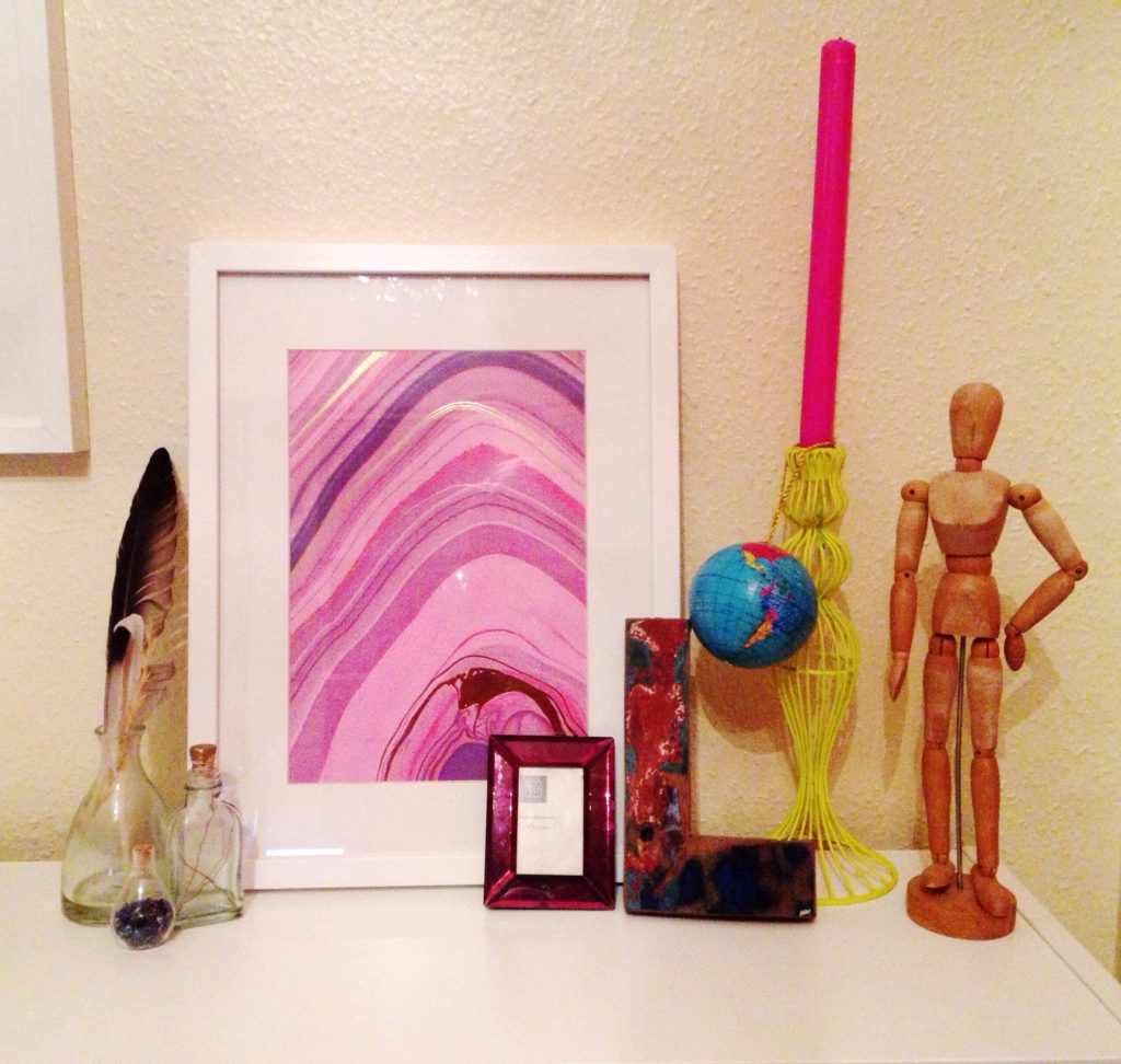 colourful-marble-art-wire-candlestick-and-other-treasures-in-a-vignette-yellow-feather-blog-living-room-tour