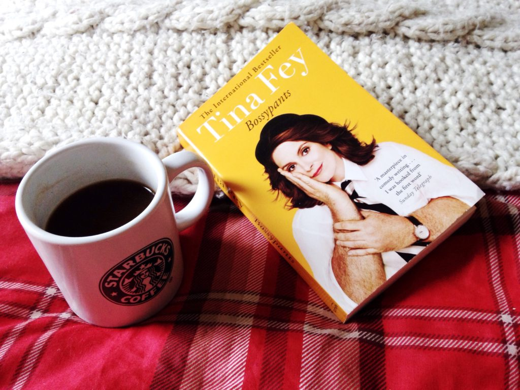 cosy weekend mornings reading in bed with coffee Tina Fey bossypants is my current read while snuggled in tartan sheets with a chunky knit throw yellow feather blog