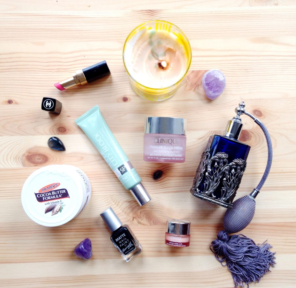 flatlay yellow feather blog ways to beat the winter blues skincare and pampering supplies