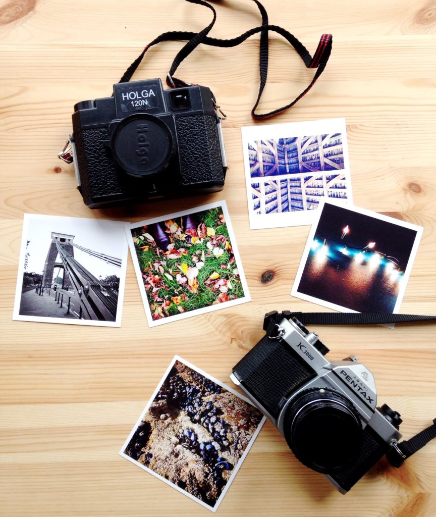 flatlay yellow feather blog ways to beat the winter blues vintage cameras and prints pentax k1000 and holga cameras