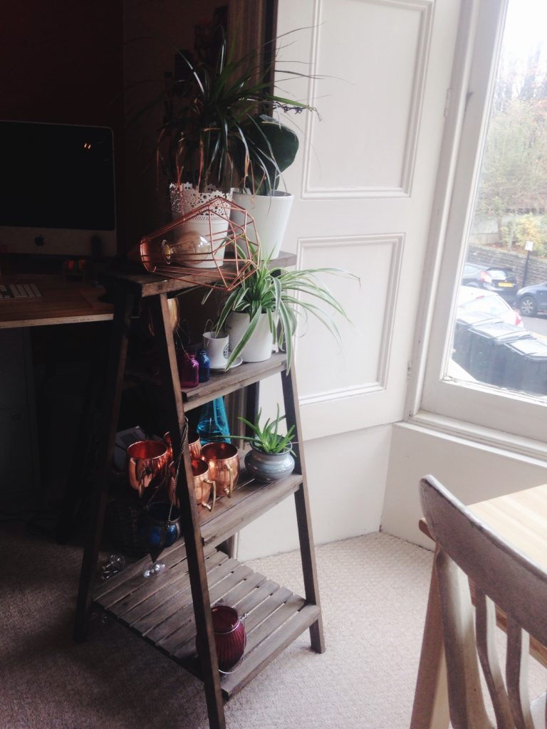 tiered-plant-stand-holding-barware-yellow-feather-blog-living-room-tour