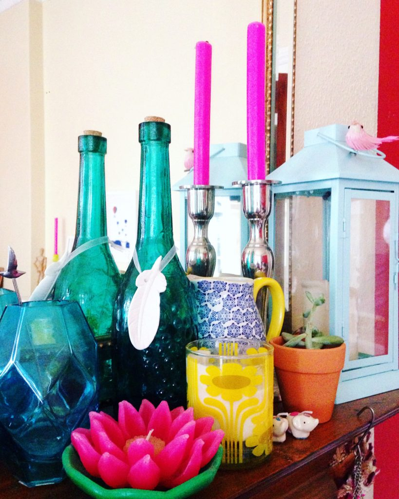 vignette-of-colourful-home-accessories-on-my-mantle-yellow-feather-blog-living-room