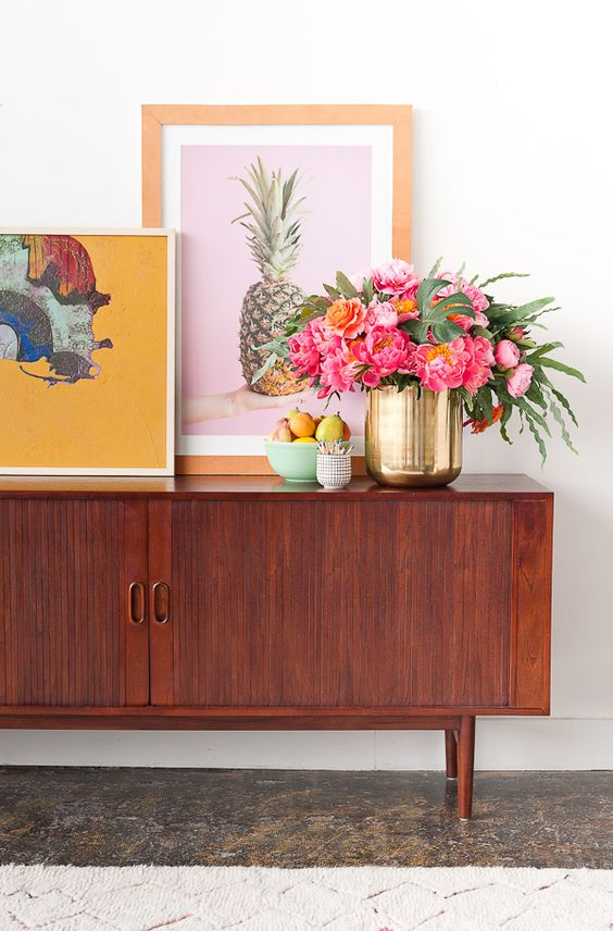 Mid century sideboard with layered artwork