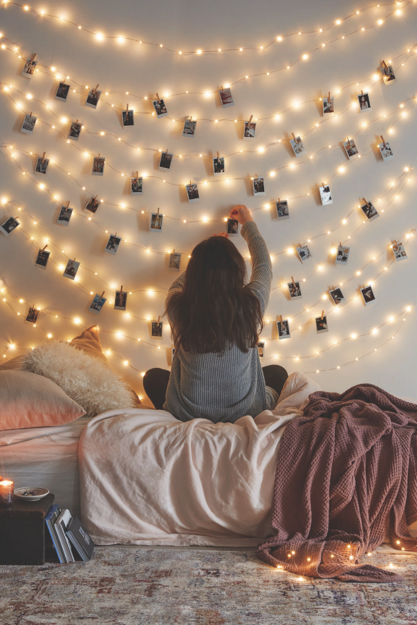 Feminine bedroom fairy lights and instax prints