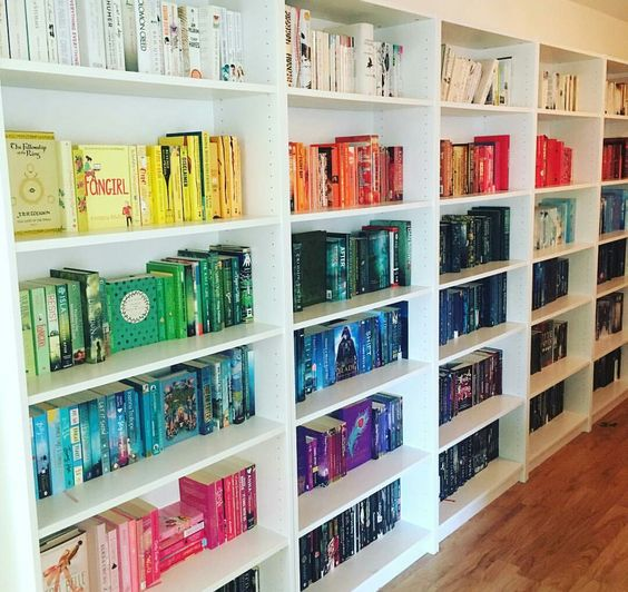 Rainbow organised bookshelves