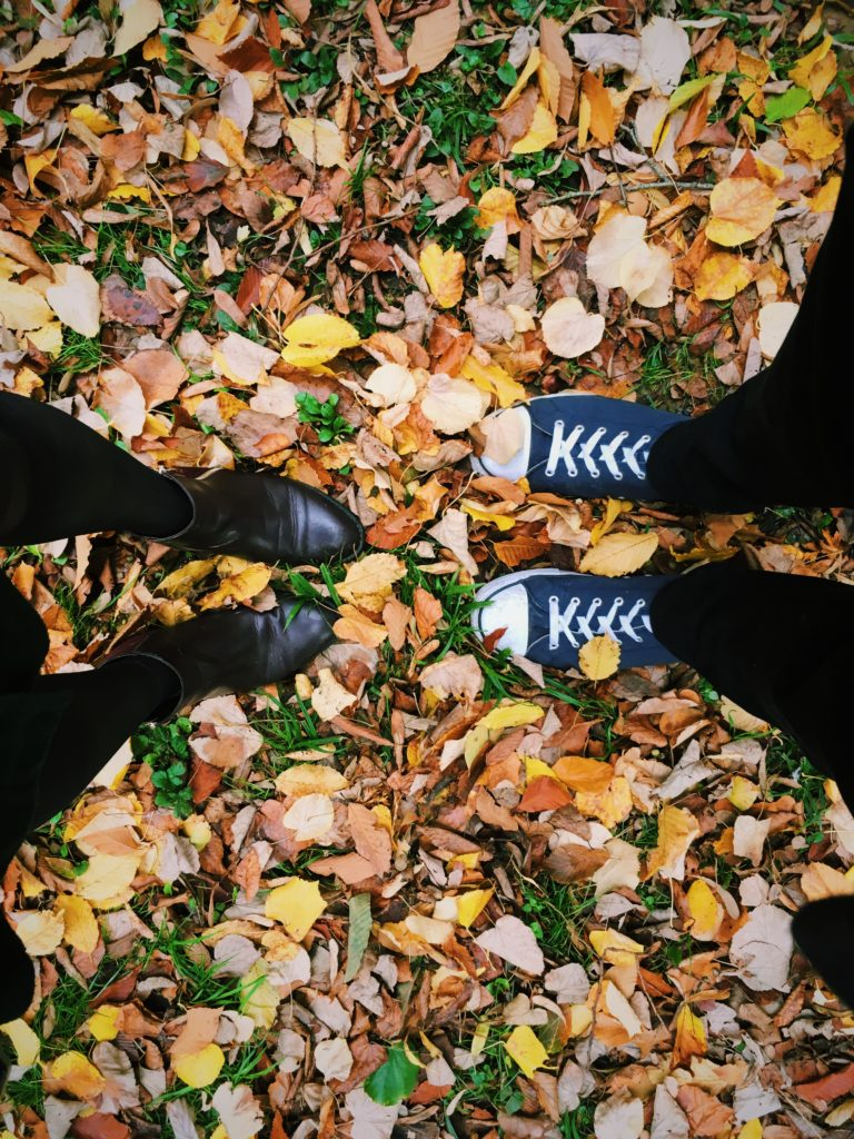Autumn walk his and hers shoes in leaves - Autumn date ideas
