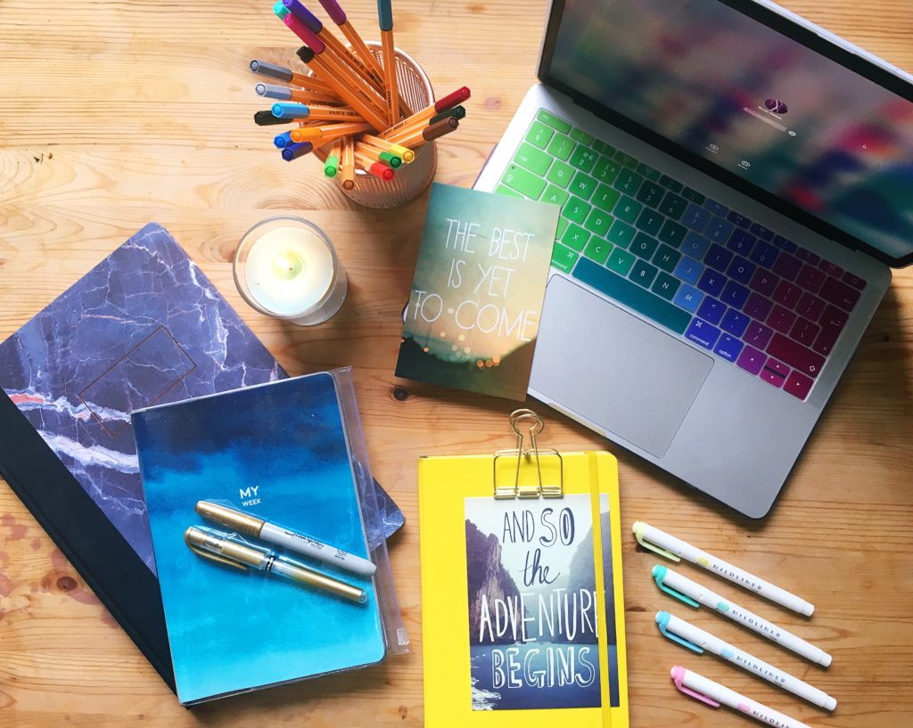 Rainbow desk flatlay Goal setting for 2018 Yellow Feather blog