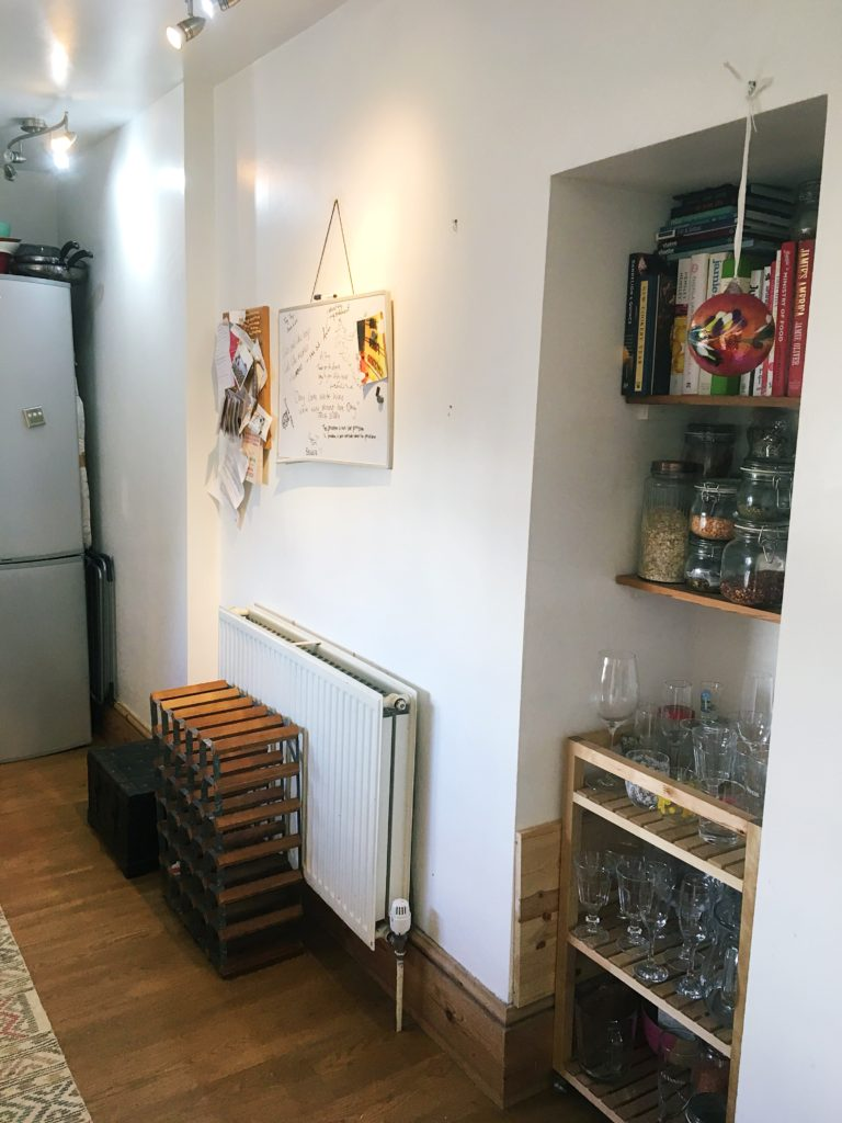 Kitchen tour yellow feather blog this side of the kitchen features a handy nook which we use to store dried goods in jars, cook books and our collection of glasses