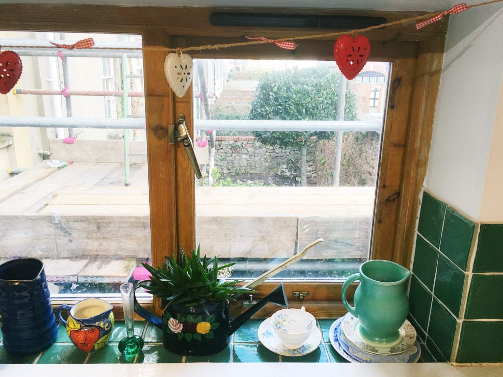 Kitchen tour yellow feather blog we use our windowsill to store pretty vases and jugs