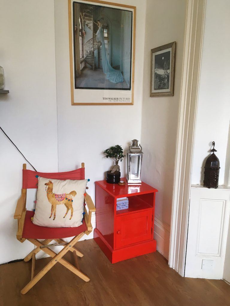 Colourful nook in my living area with pops of red Living area tour yellow feather blog