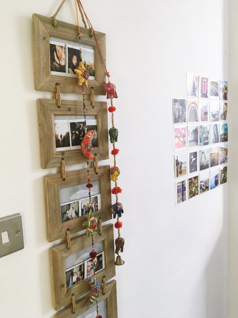 driftwood-photo-frames-with-hanging-indian-garland-yellow-feather-blog-bedroom-tour