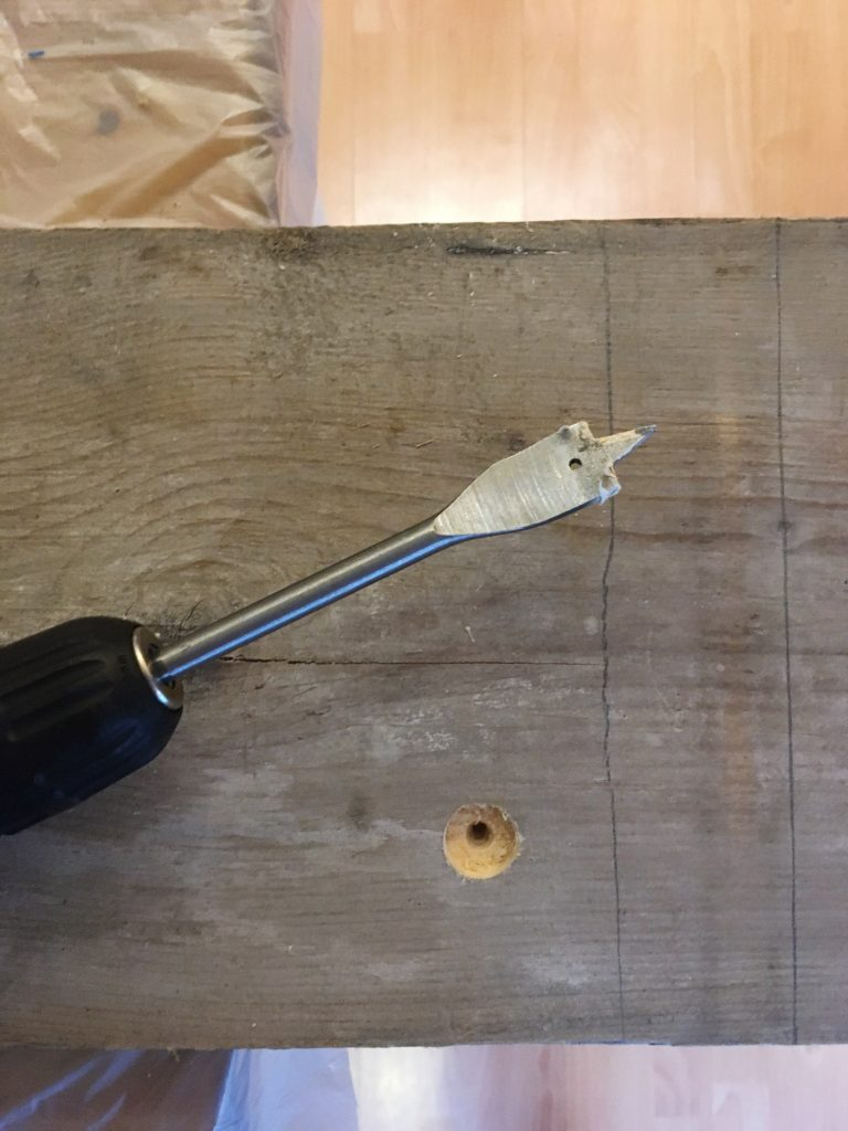 Drilling-hole-for-wine-glass-stem-with-spade-bit-yellow-feather-blog-DIY-wooden-bath-caddy