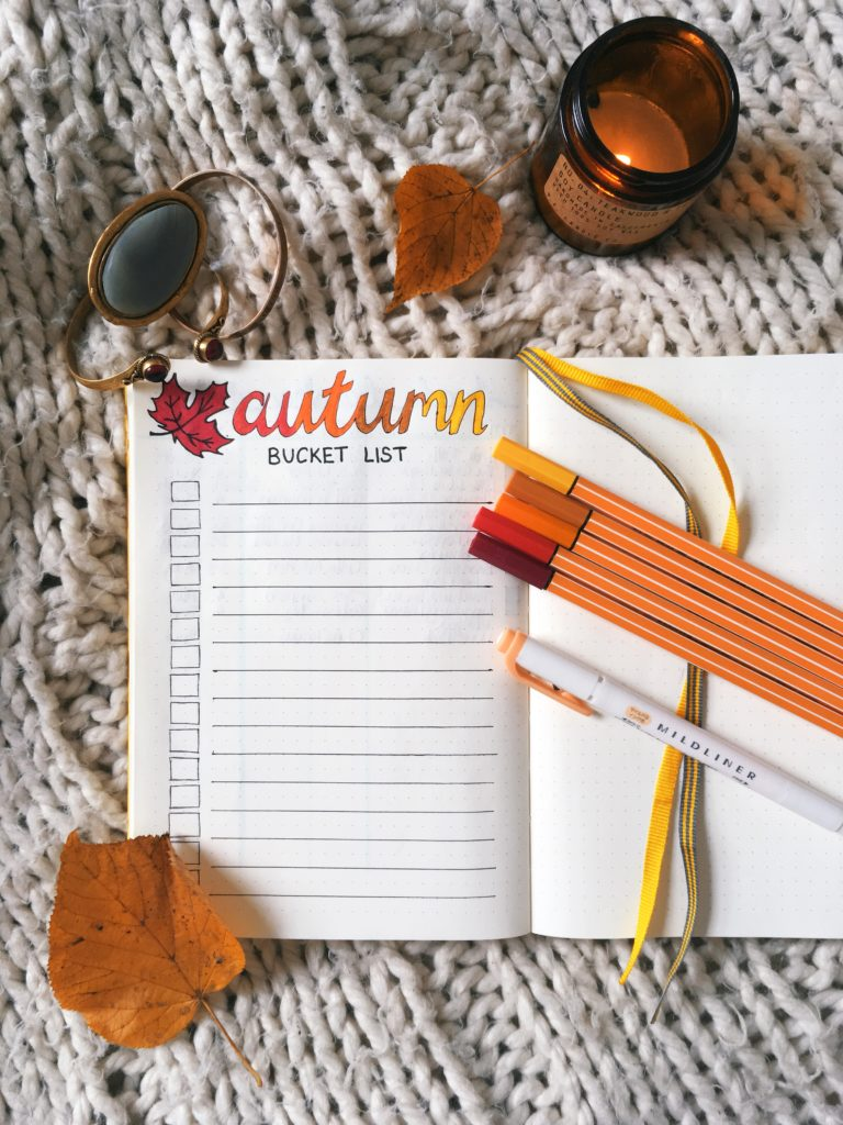 Autumn bucket list bullet journal spread flatlay yellow feather blog 2