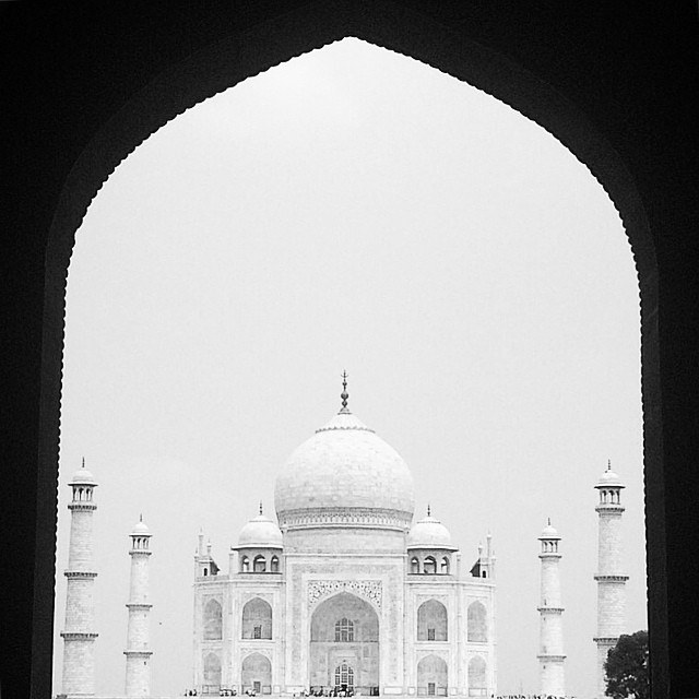 Black and white photo of the Taj Mahal through arch Agra India Yellow Feather Blog Travel Tuesday Instagrammable locations
