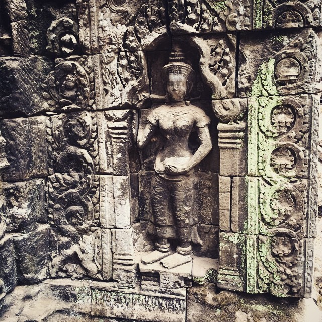 Carving Ta Prohm tree temple Angkor Wat Cambodia Yellow Feather blog travel tuesday instagrammable locations
