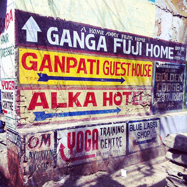 Colourful signs on street corner Varanasi India Yellow Feather Blog Travel Tuesday Instagrammable locations