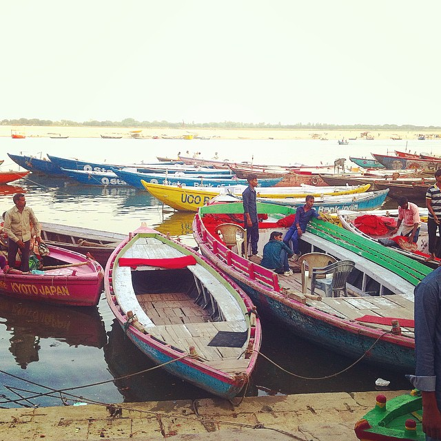 Colourful wooden fishing boats on tha Ganges Varanasi India Yellow Feather Blog Travel Tuesday Instagrammable locations