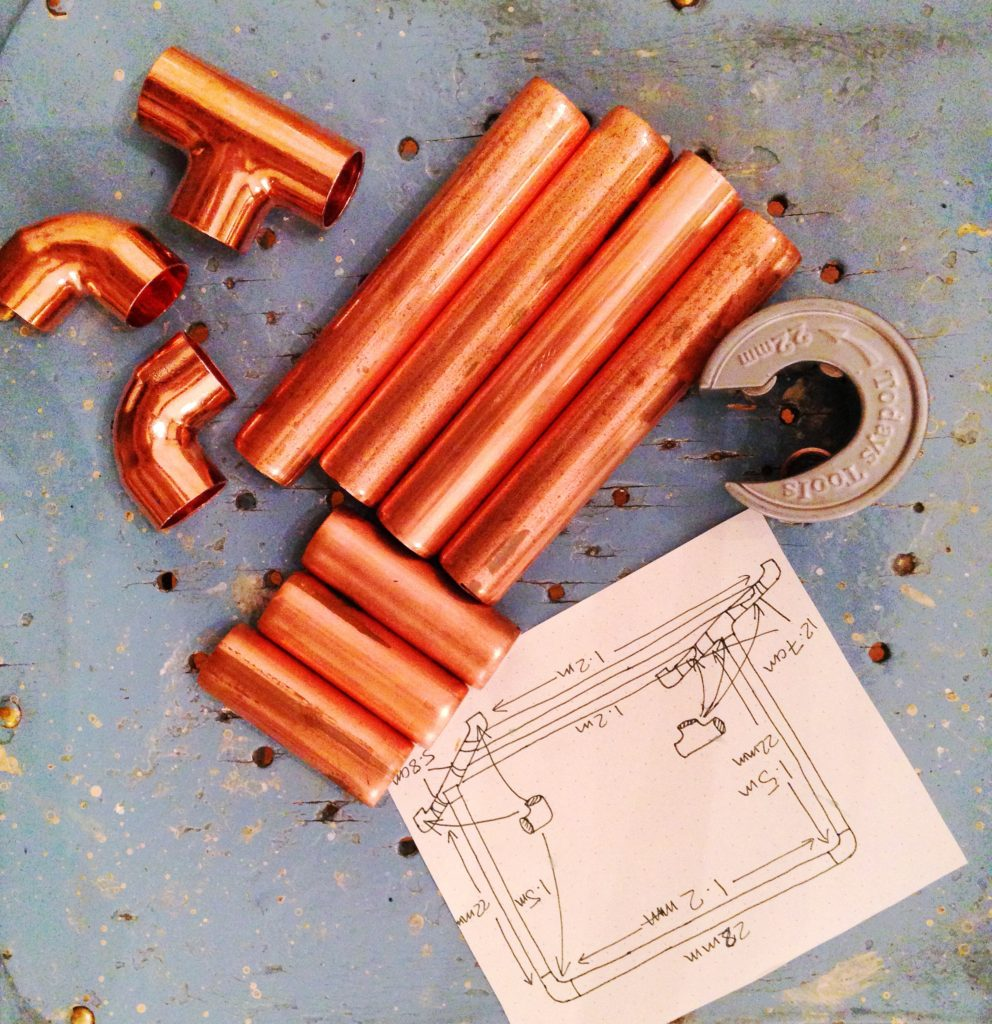 Cut lengths of copper pipe for DIY copper clothes rail yellow feather blog