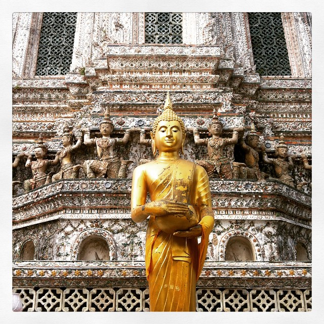 Golden Buddha statue in front of Wat Arun temple in Bangkok Yellow Feather Blog Travel Tuesday Instagrammable Locations