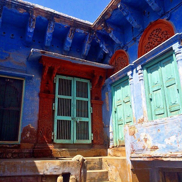 Green shutter in blue wall Jodhpur the blue city Rajasthan India Yellow Feather blog travel tuesday instagrammable locations