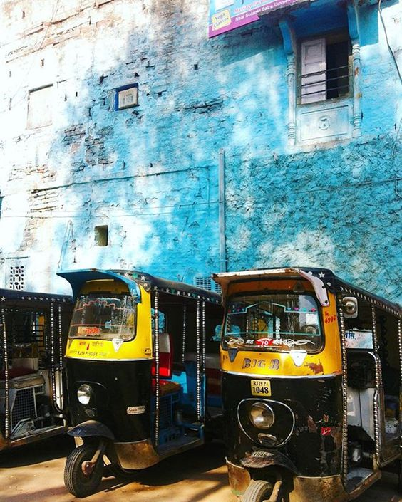 Rickshaws in front of Blue wall Jodhpur blue city Rajasthan India Yellow Feather blog travel tuesday instagrammable locations