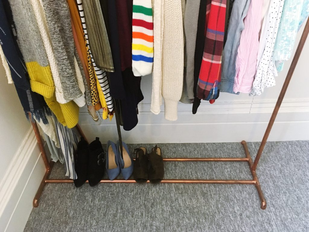 Shoe storage on DIY copper clothes rail yellow feather blog