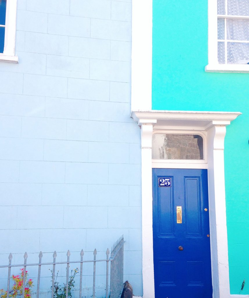 blue door in turquoise house colourful painted houses colourful cliftonwood yellow feather blog