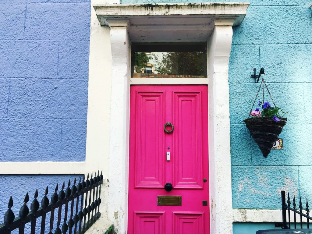 pink door in yellow and blue painted house colourful cliftonwood yellow feather blog